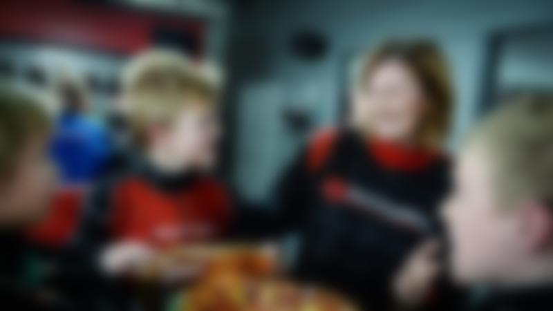 Family eating at TeamSport Karting London Docklands in Charlton