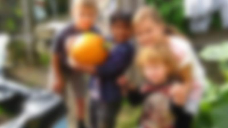 Kids with pumpkin at Newham City Farm in Beckton