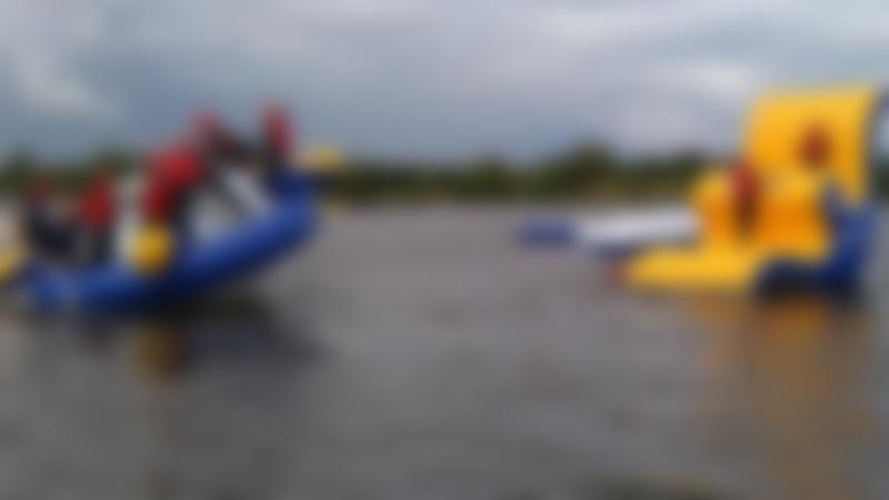 People on inflatable course on lake at Waves Leisure Complex in Craigavon