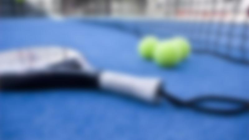 Tennis racket and balls at Eddie Irvine Sports in Bangor