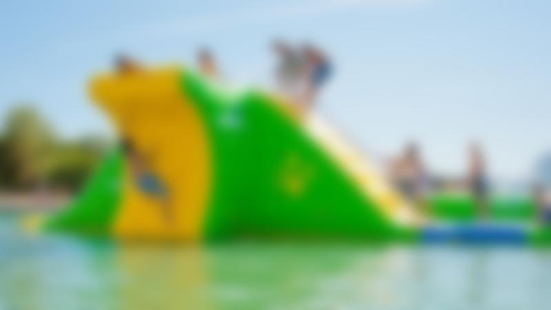 Kids ascend the slippery inflatable climbing wall