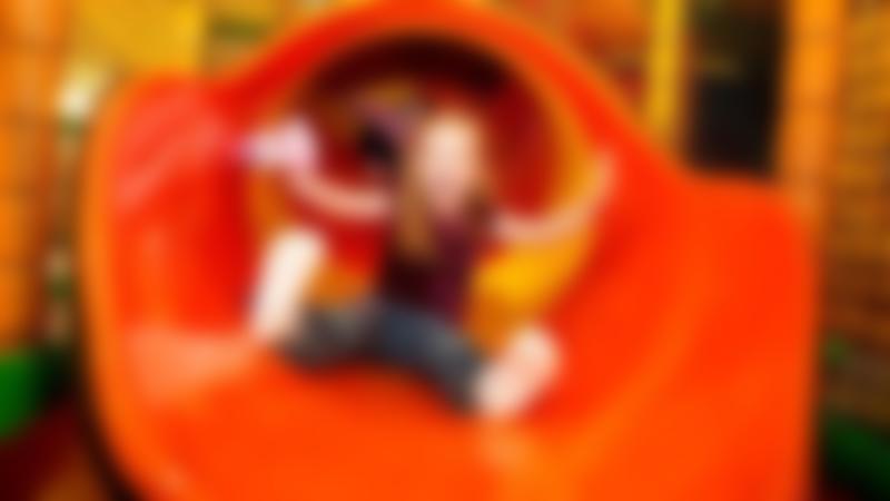 Girl on slide at Leos Funzone Huntingdon
