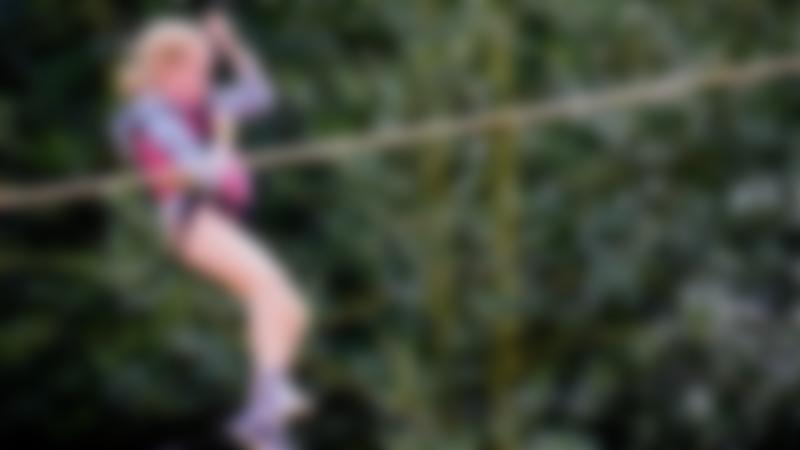 Girl on zip wire at Skywalk Adventure in Esher