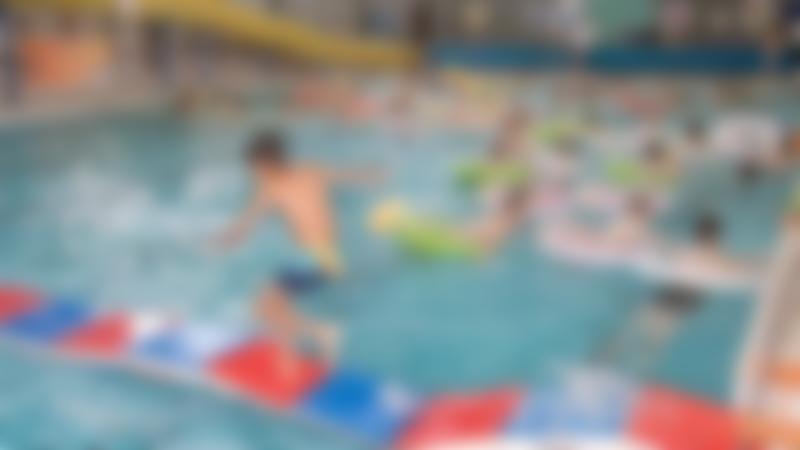 Kids swimming in Eccleshill Pool at Bradford