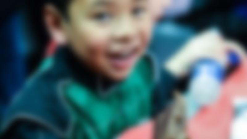 Little boy eating some cake at TeamSport Indoor Karting Preston