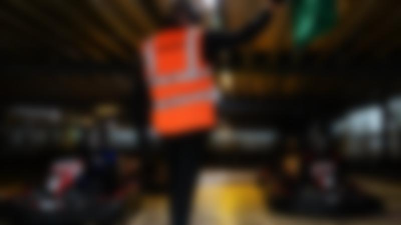 Man waving a green flag at TeamSport Indoor Karting Preston