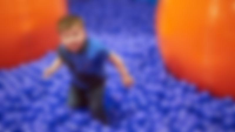Boy in a ball pit