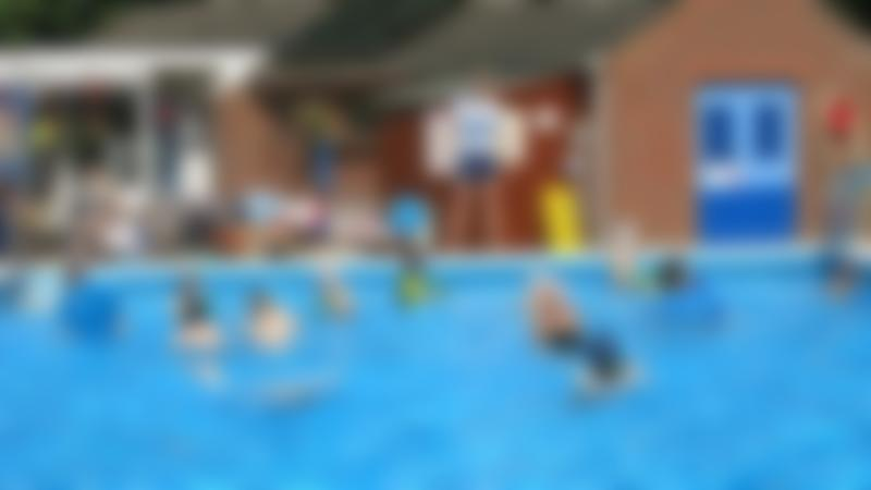 People in outdoor swimming pool at Lazonby Swimming Pool in Penrith