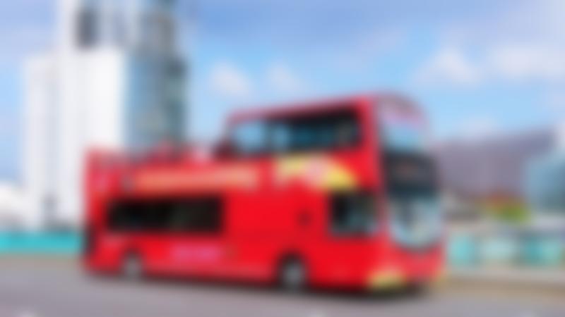 Passengers on City Sightseeing Belfast Hop on Hop off Tour bus