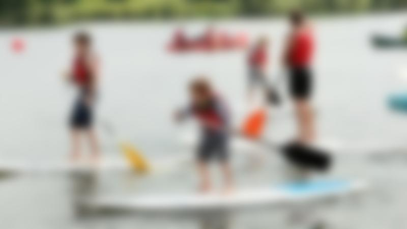 Kids on paddle boards at Dinton Activity Centre in Hurst