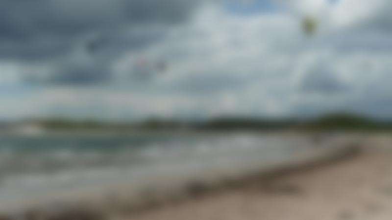 People parachuting at Beadnell Beach