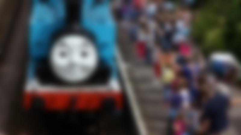 Families wave at Thomas the Tank Engine at Llangollen Railway