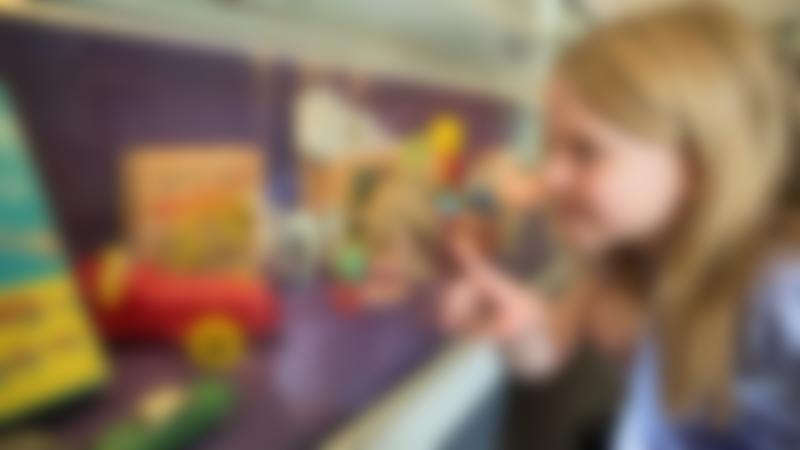 Girl looking at display in Wakefield Museum