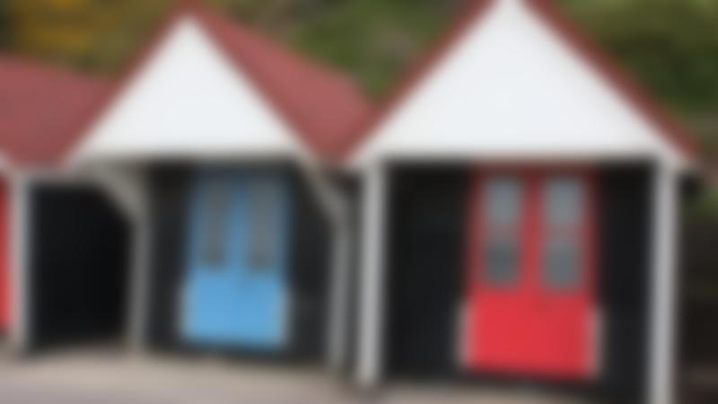 Beach huts on sea front on Curious About Bournemouth trail