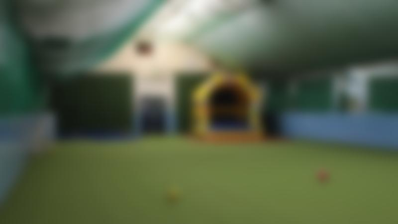 Indoor football pitch and bouncy castle at Westows Adventure Play area in Hove
