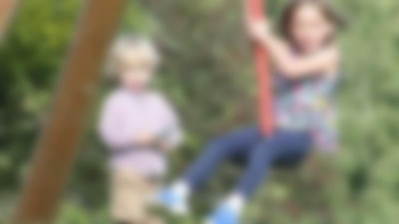 Girl on zip wire at Wonder Woods at Stonor in Henley-on-Thames