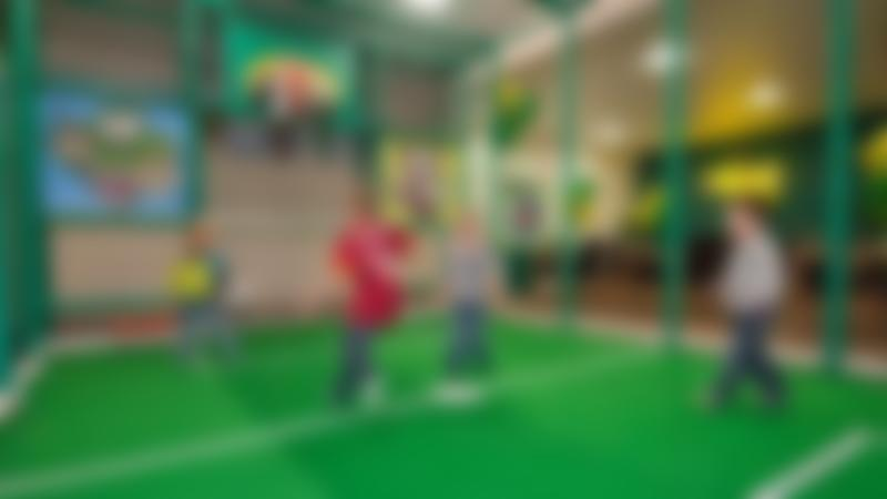 Boys playing indoor football at Jungle Kids in Leeds