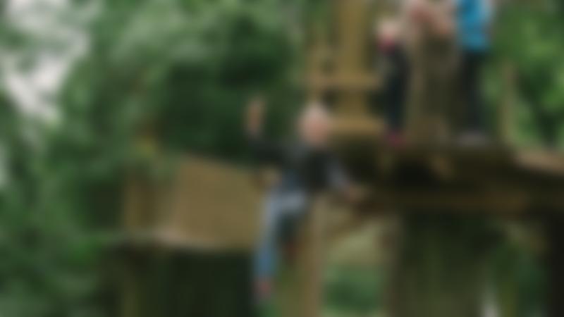 Boy on zip wire at Go Ape Woburn
