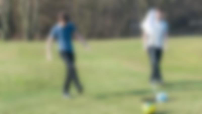 Boys playing footgolf at Lee Valley Golf Course in Edmonton