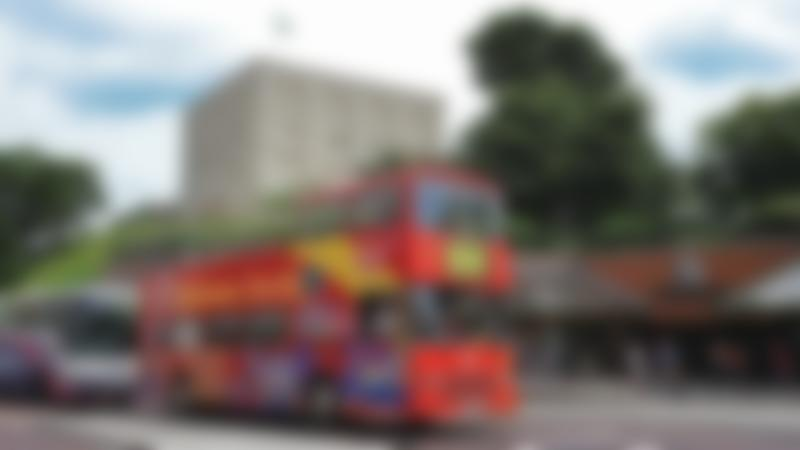 City Sightseeing Norwich bus passes Norwich Castle