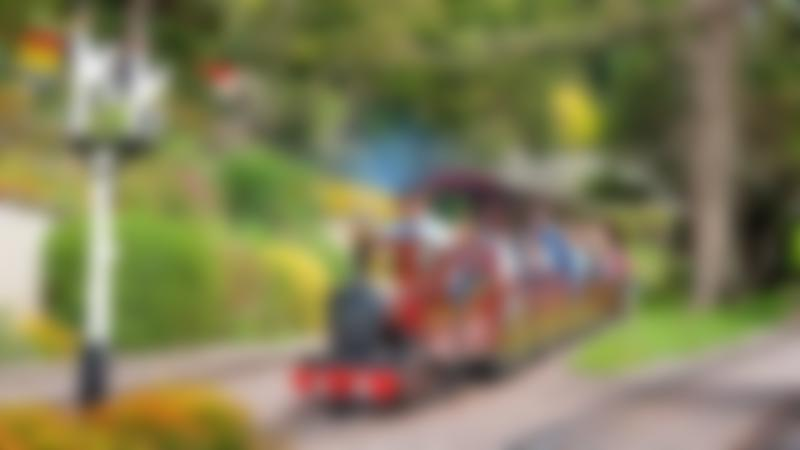Families on miniature train at Beer Heights Light Railway in Seaton