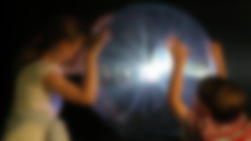 Kids by see-through ball at Camera Obscura and World of Illusions in Edinburgh