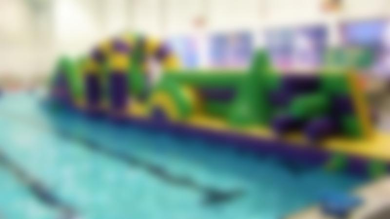 Inflatable course on swimming pool at GL1 in Gloucester