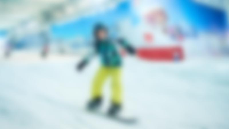 Girl snowboarding at The Snow Centre in Hemel Hempstead