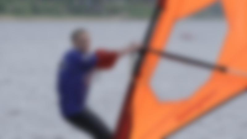 Woman windsurfing at Debdale Outdoor Centre in Gorton