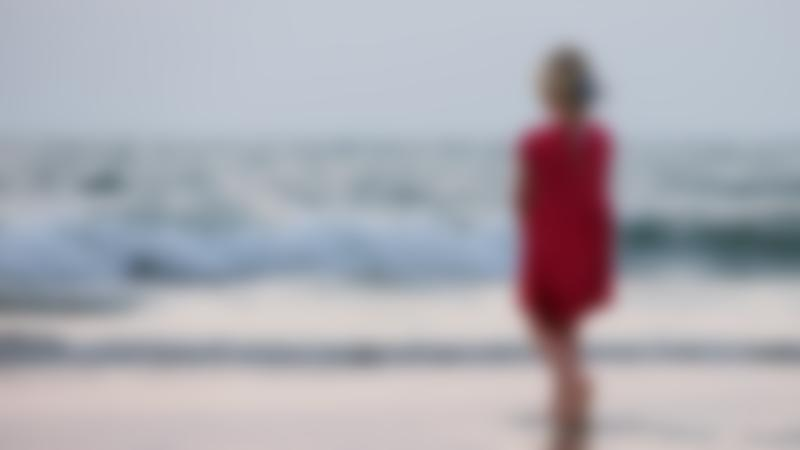 Girl standing on a sandy beach