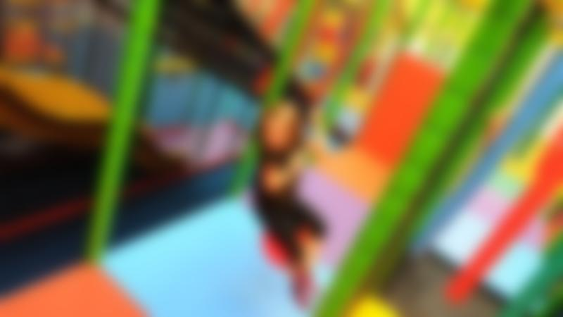 Girl playing on soft play frame at Tigers Indoor Play in Daventry
