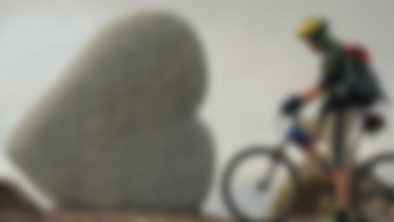 Mountain biker at Heart-Cleft Stane at 7stanes Dalbeattie