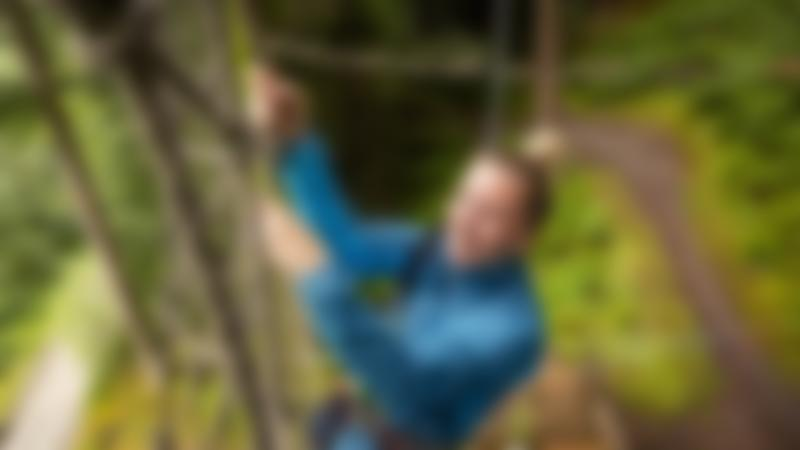 Girl climbing up some ropes at Go Ape Peebles