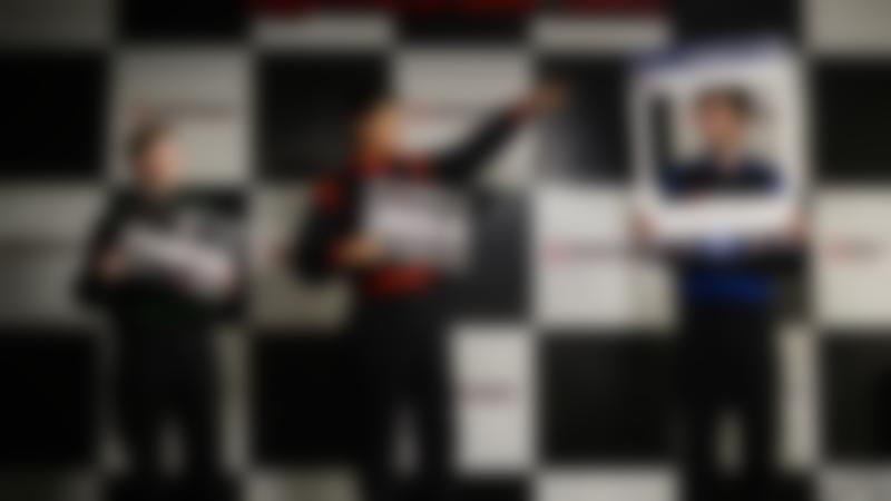 Boys on winners podium at TeamSport Indoor Karting Tower Bridge in London