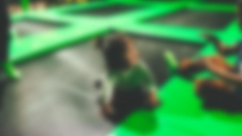 Toddler on trampoline at Flip Out Stoke in Stone