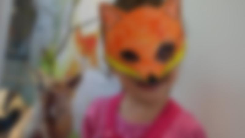 Girl wearing fox mask at Derby Museum and Art Gallery