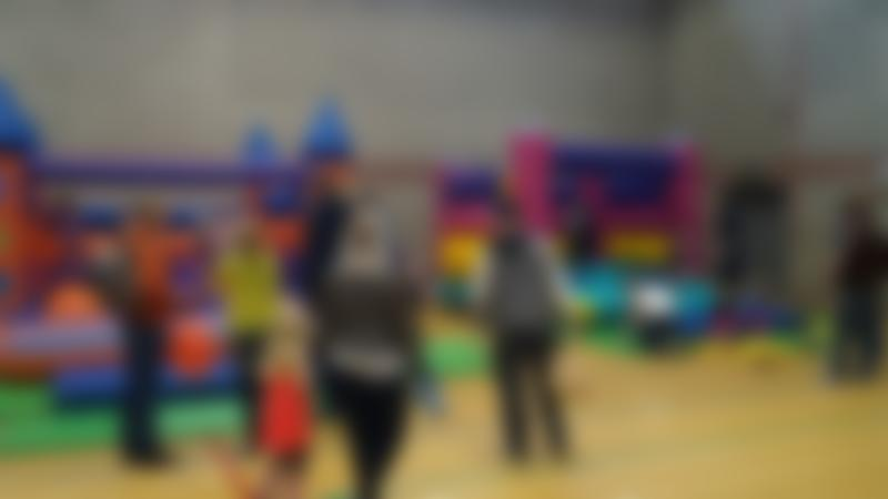 Kids on bouncy castle at Newburn Activity Centre in Newcastle Upon Tyne