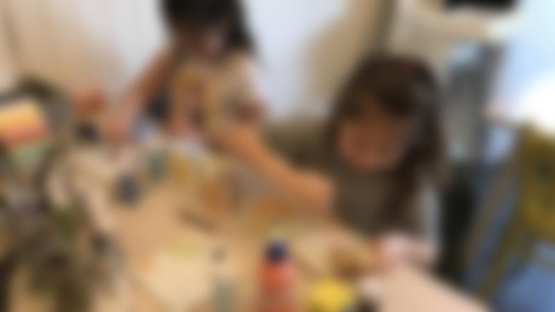 Two young kids enjoy painting pottery at Canny Crafty in Gosforth