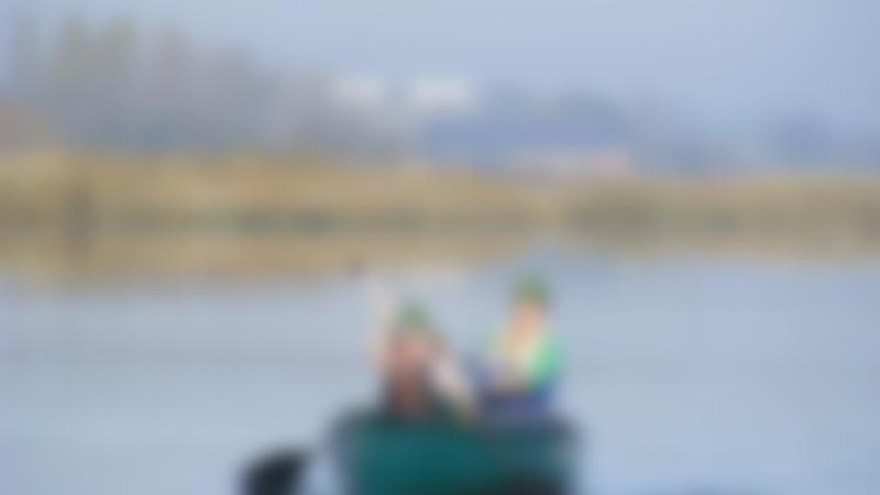 Mum and son on canoe at Iken Canoe in Woodbridge