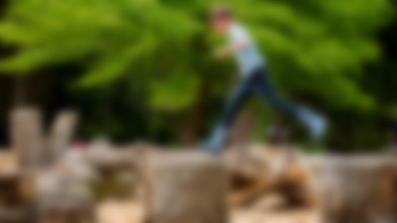 A little boy playing at Dyffryn Gardens in St Nicholas