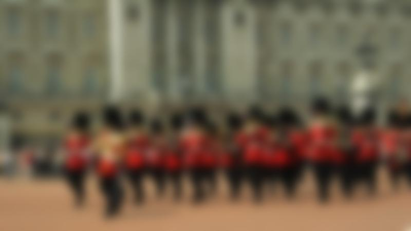 Guards marching outside Buckingham Palace at The Royal Mews in London
