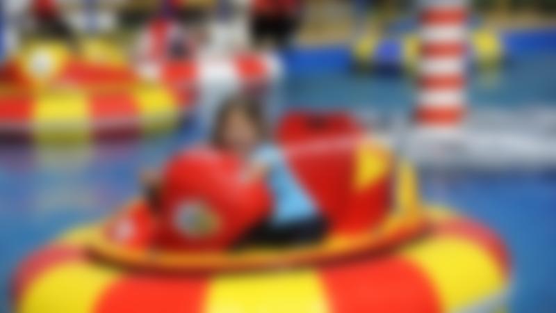 Girl on blaster boat at Adventure Wonderland in Christchurch