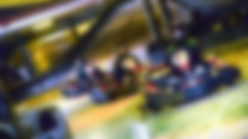 Three people racing at TeamSport Indoor Karting Manchester Trafford