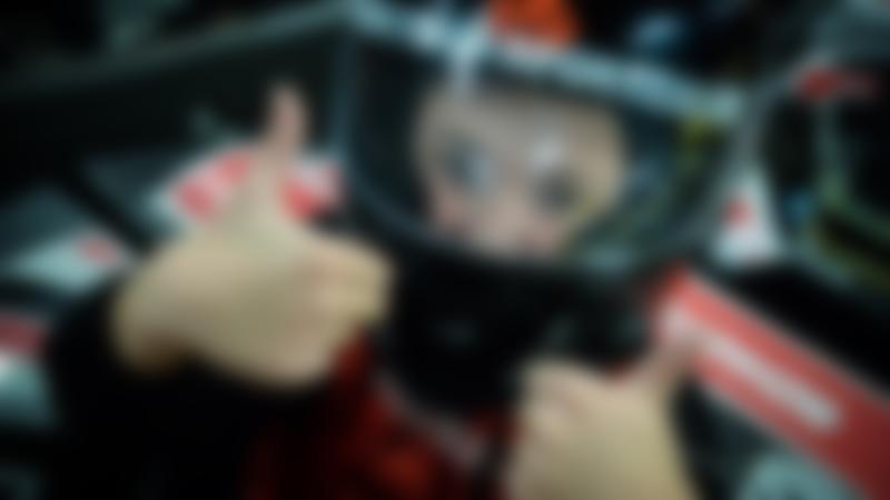 A little boy smiling at TeamSport Indoor karting Manchester Trafford Park